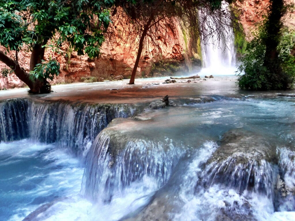 waterfalls, water, red mountains and trees The Grand Canyon, Arizona