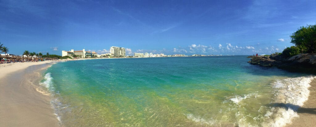 View of the beach with resorts in the distance in Cancun