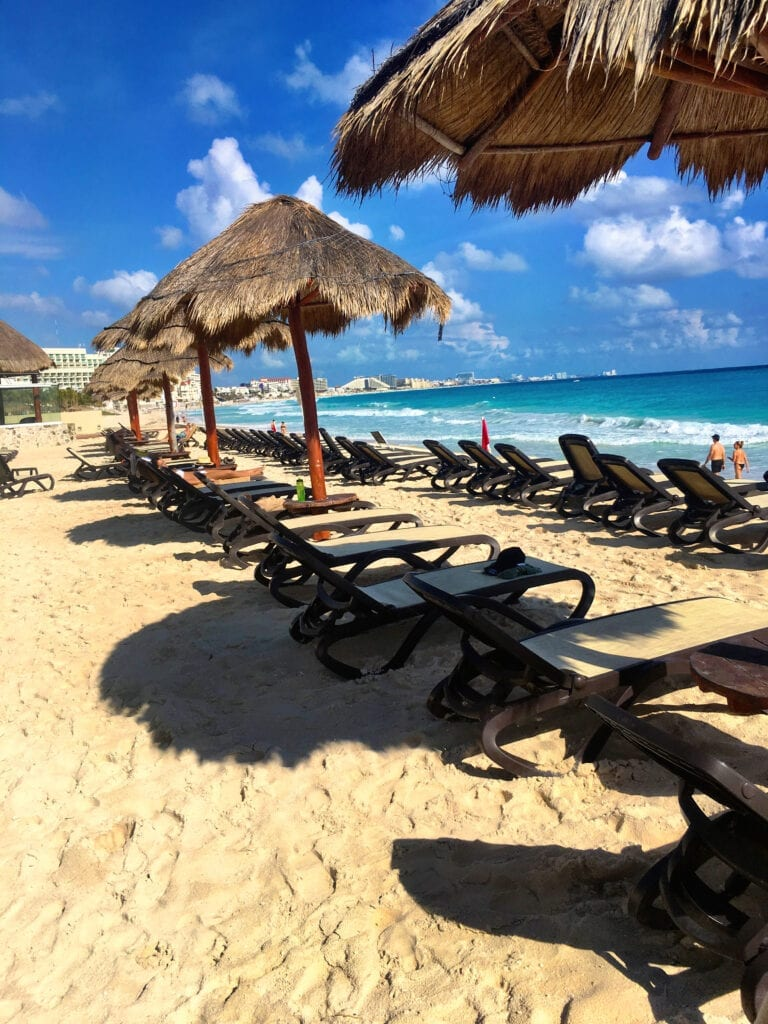 Beach and chairs with umbrellas on the beach