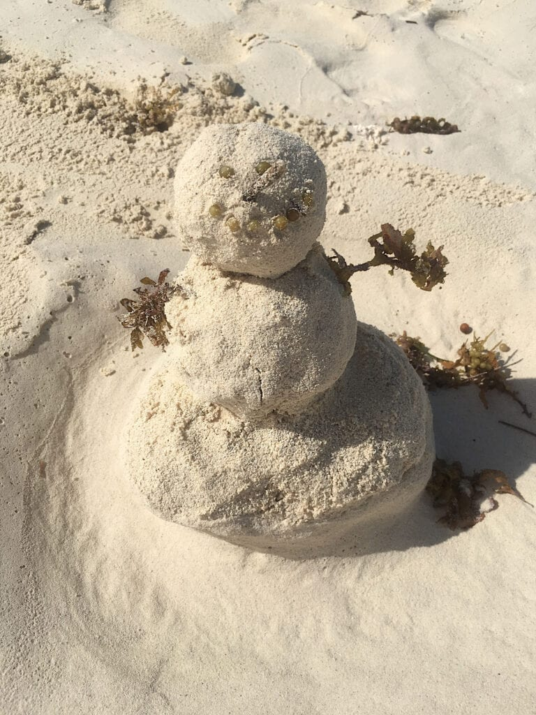 """""""Sand Man"""" Snow man made out of sand at the beach"""