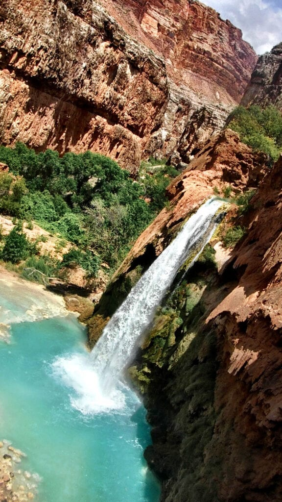 Havasu Falls Waterfall beautiful against the red mountains in The Grand Canyon, Arizona