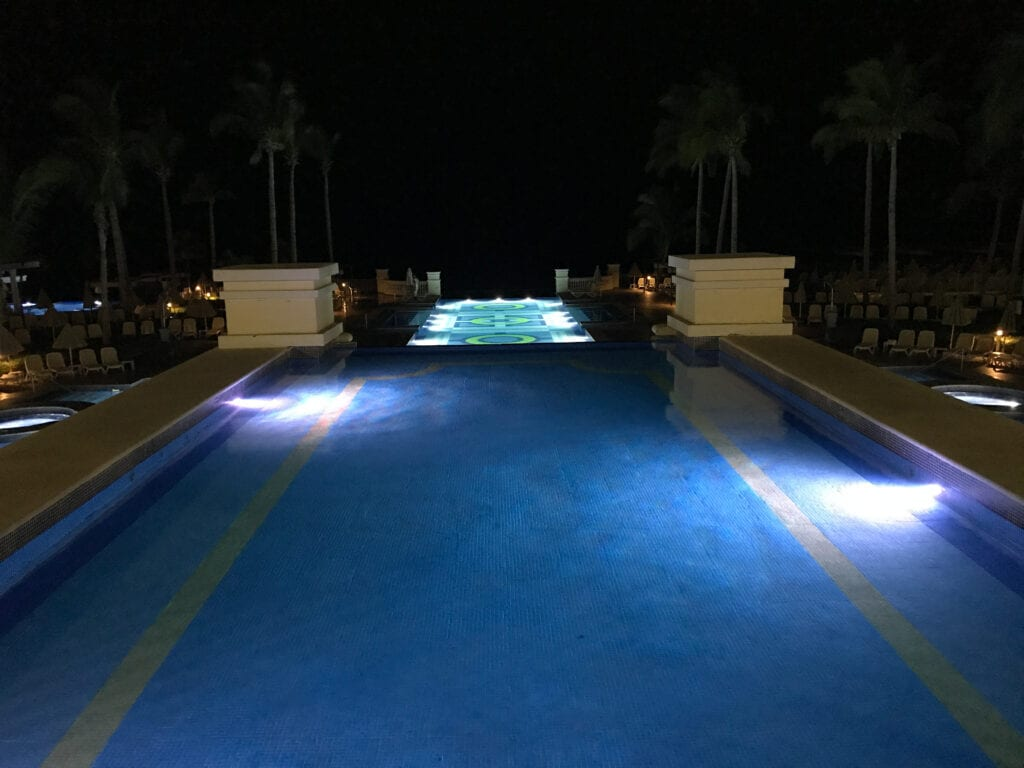view of the illuminated pool at night at the Rui Hotel and Resort, Cabo San Lucas, Mexico