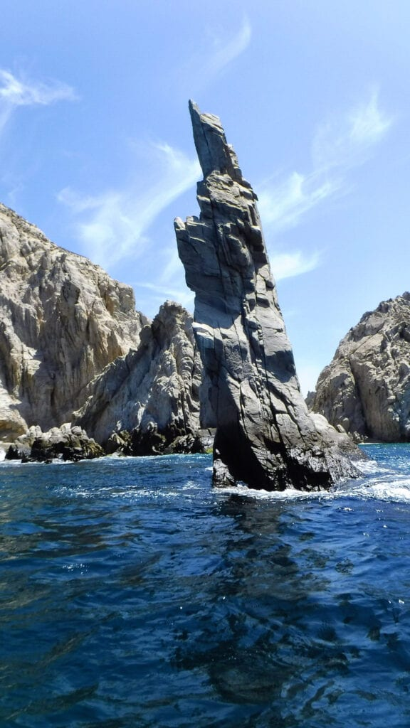rock formation standing out of the ocean Cabo San Lucas, Mexico