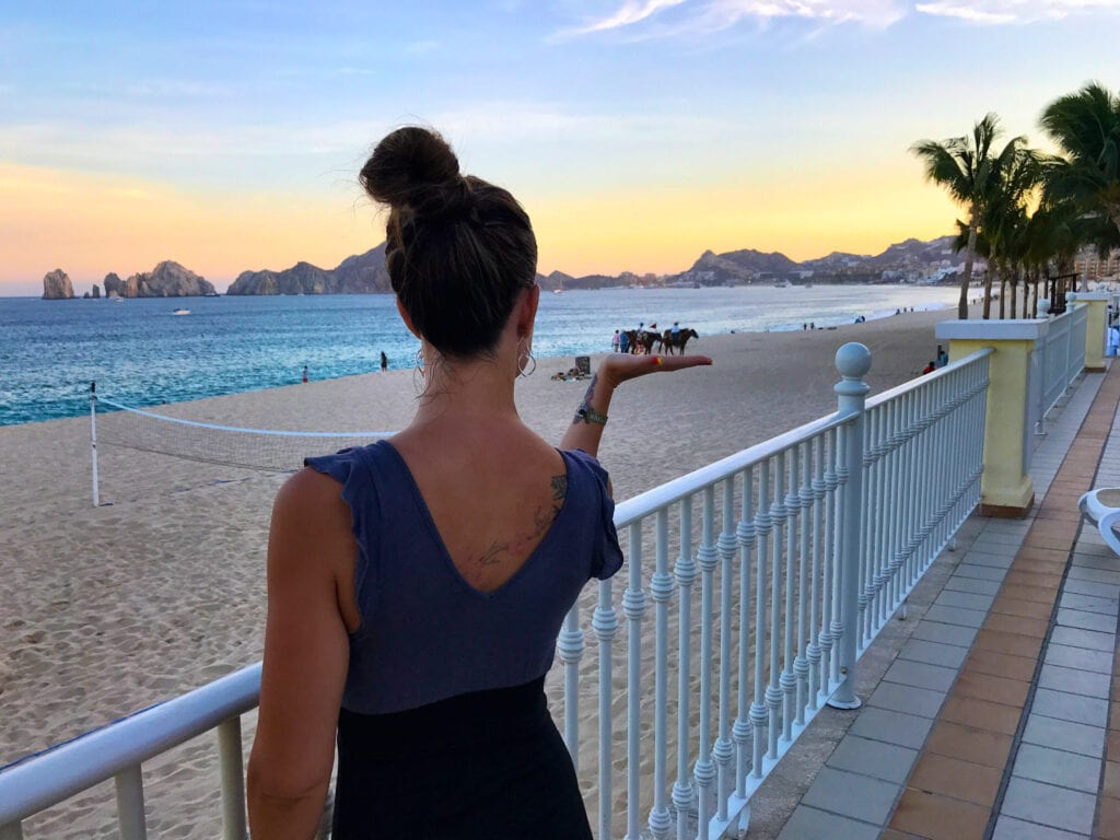 creative beach shot, woman holding horses the Rui Hotel and Resort, Cabo San Lucas, Mexico