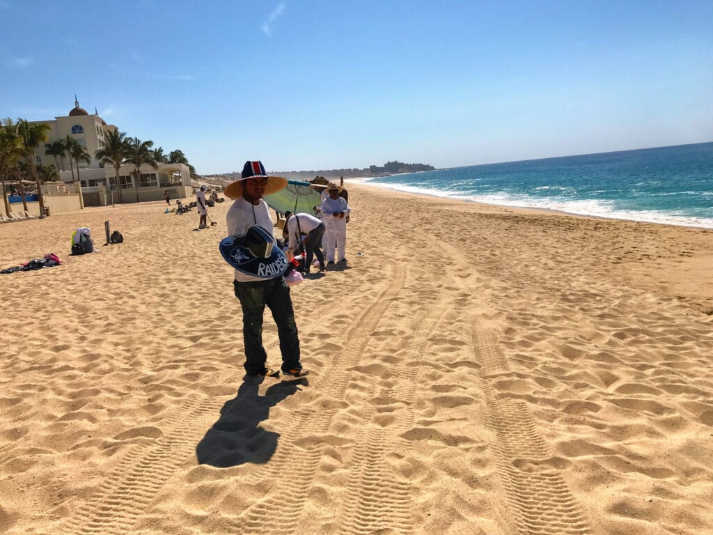 man selling goods at the Rui Hotel and Resort, Cabo San Lucas, Mexico. beach and ocean views