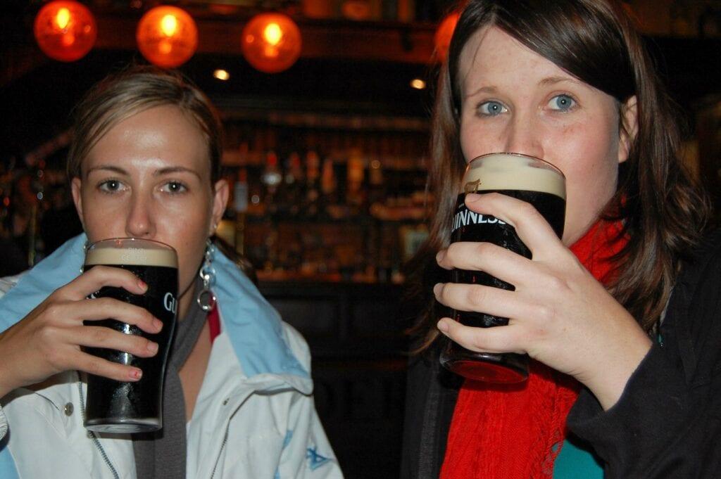 Girls drinking Guinness in Scotland pub