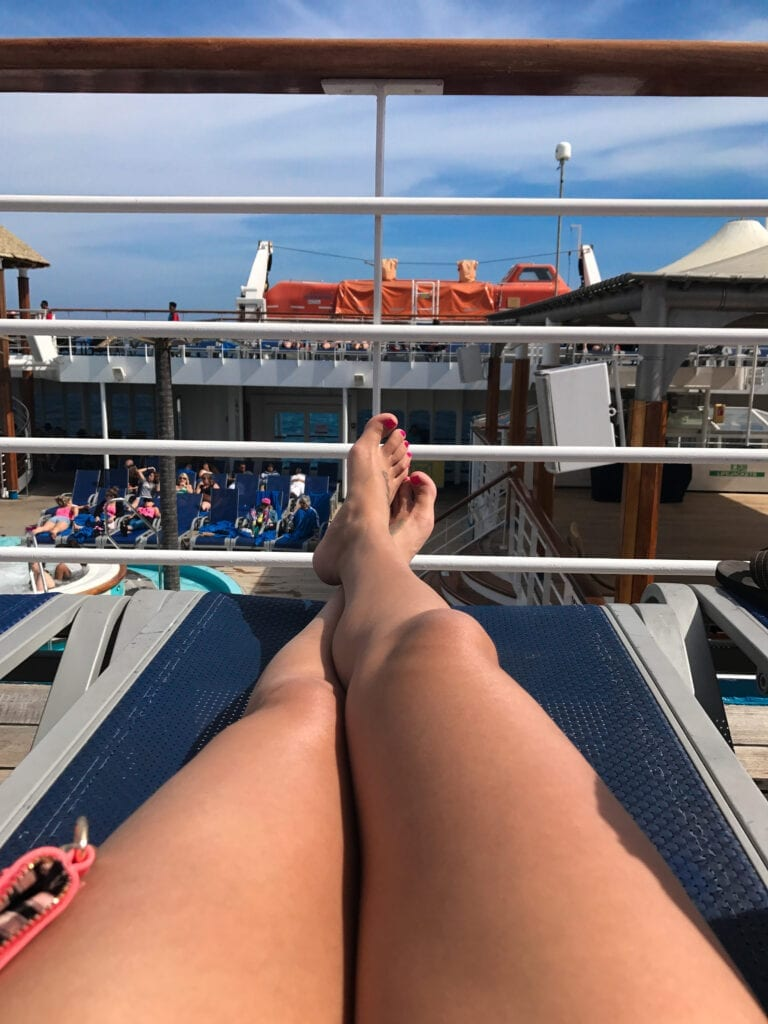girl's legs hanging out on the cruise ship