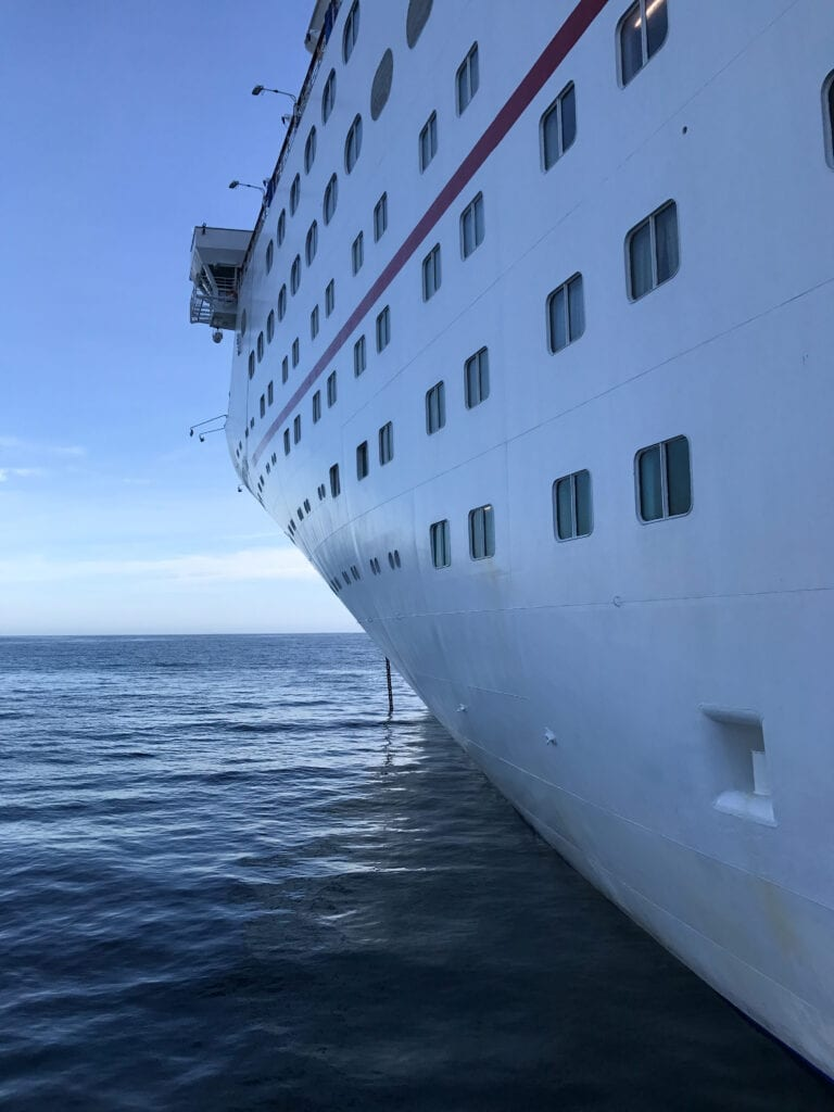 view of the side of a cruise ship from the water