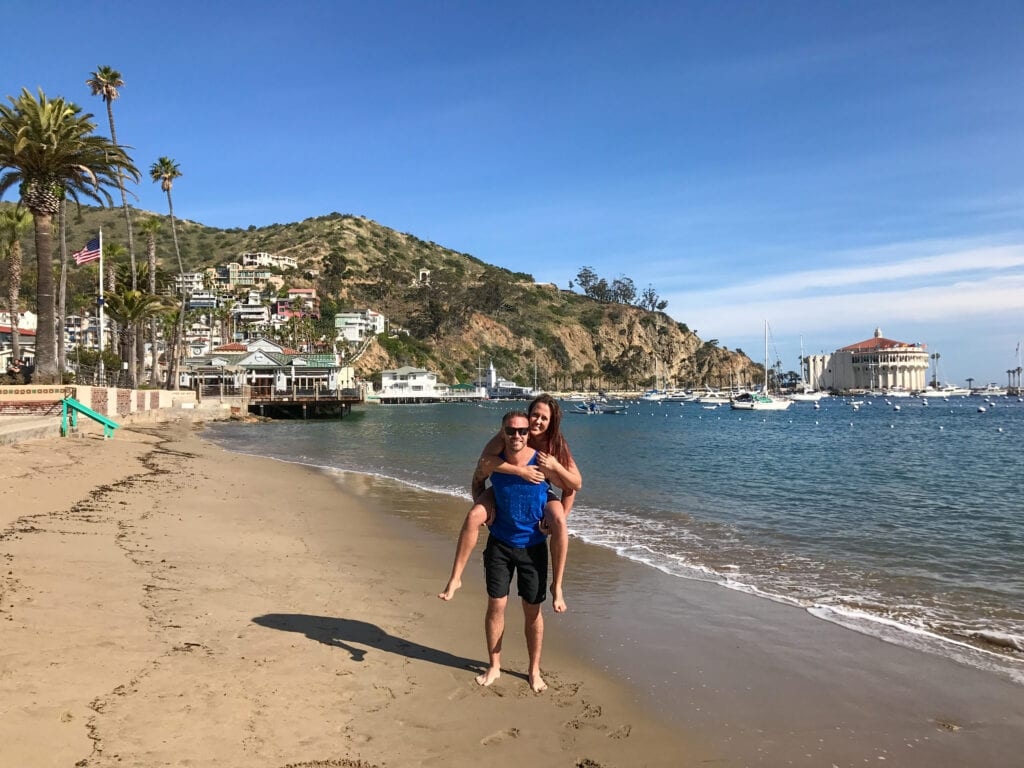 Man giving girl piggy back ride on Catalina Island