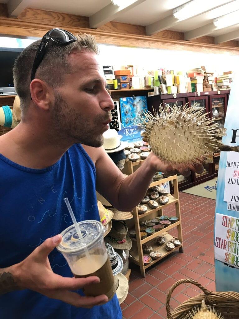 Man pretending to kiss puffer fish