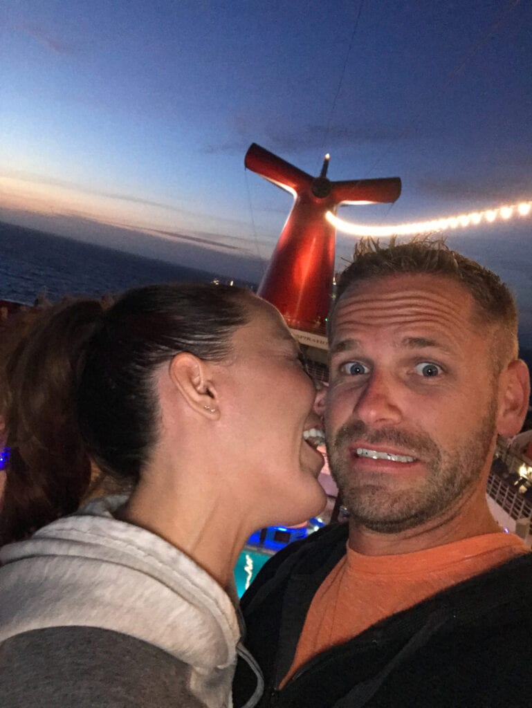 Man and women messing around on cruise ship making silly faces