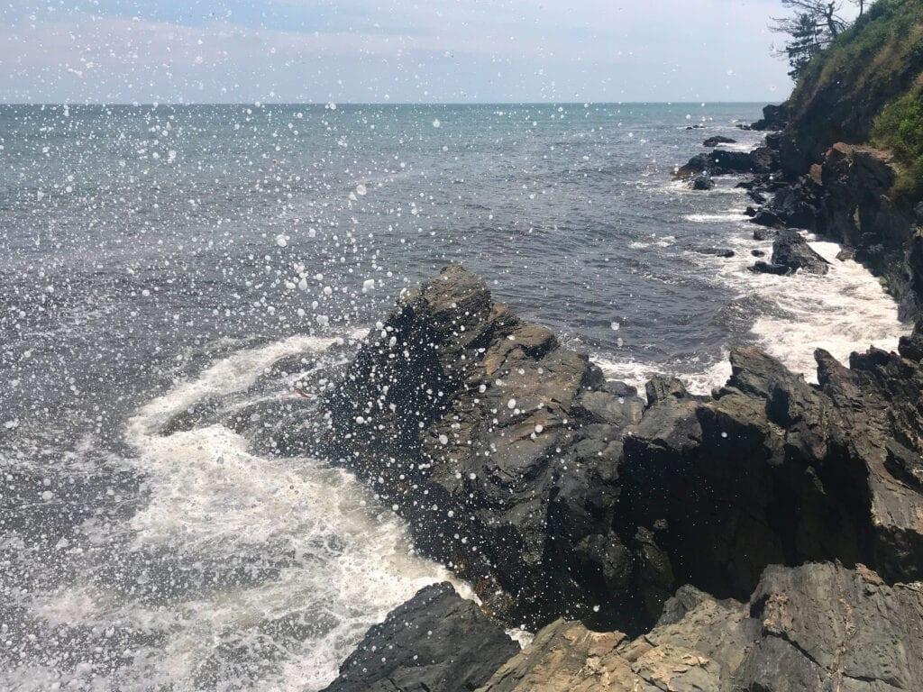 Waves crashing against rocks at Easton's Beach, Rhode Island