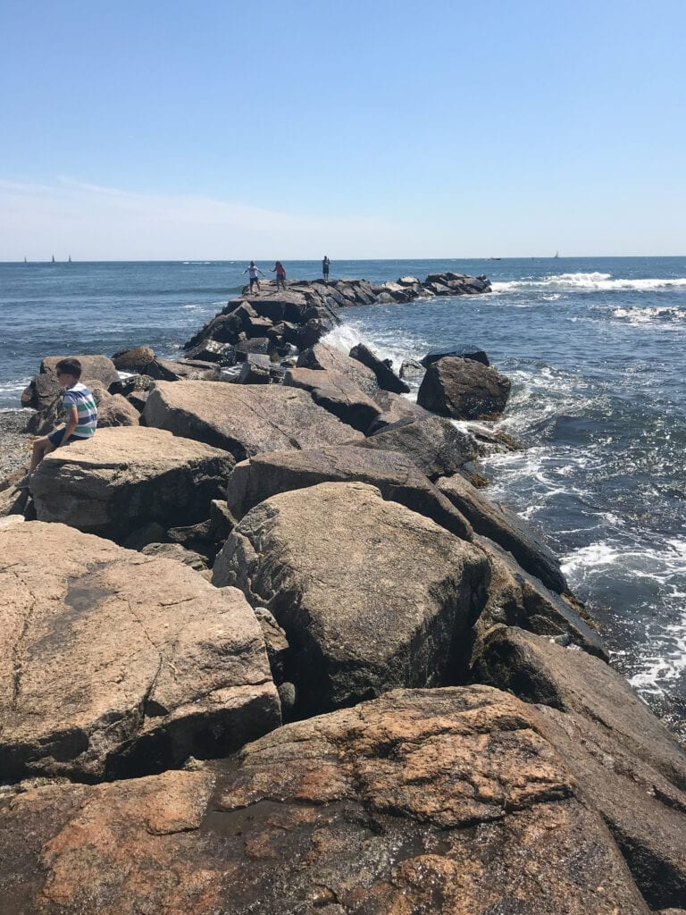 Large rock path over the ocean at Easton's Beach