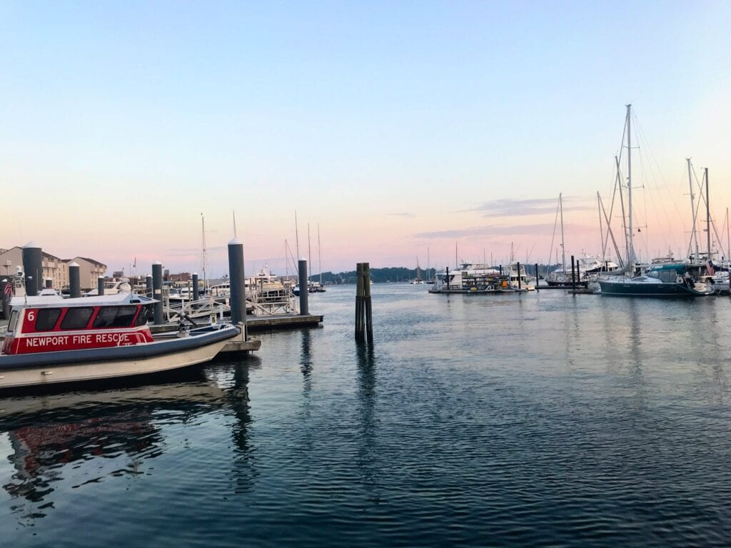 Newport Harbor sunrise with boats on the water