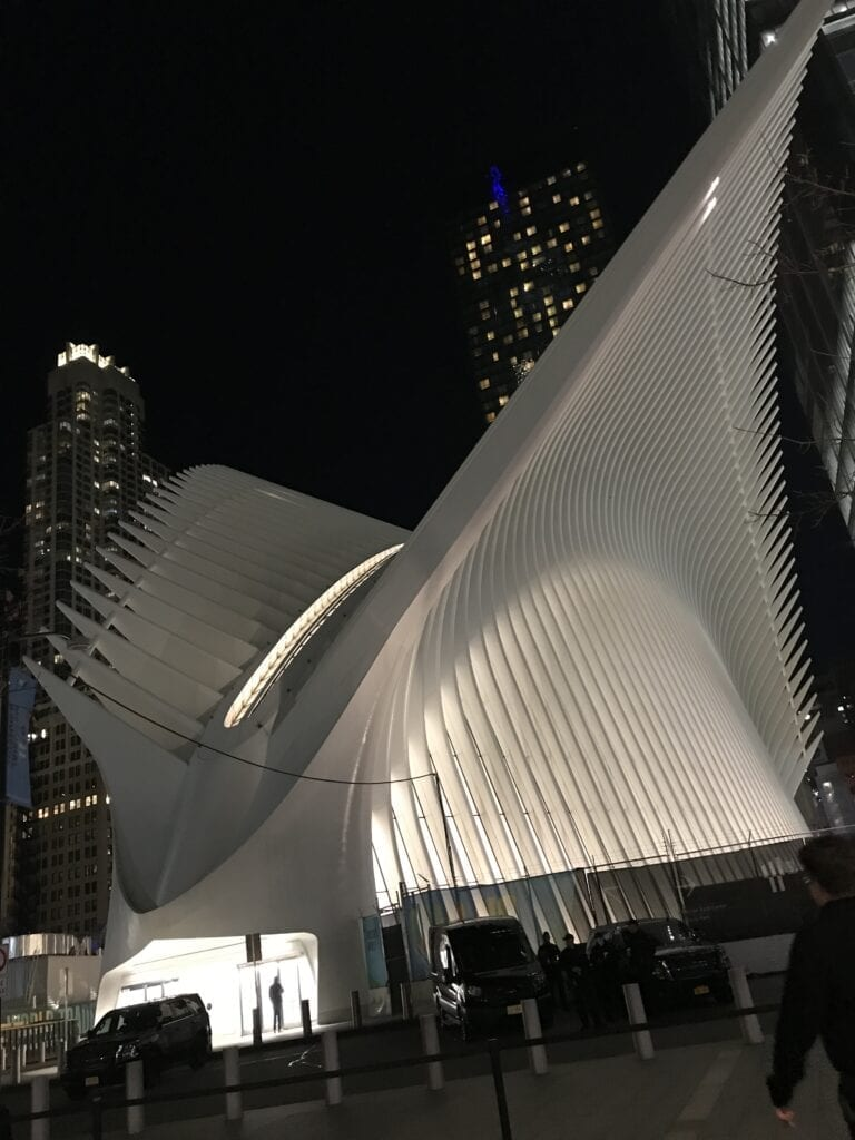 World Trade Center Station outside of building at night in New York
