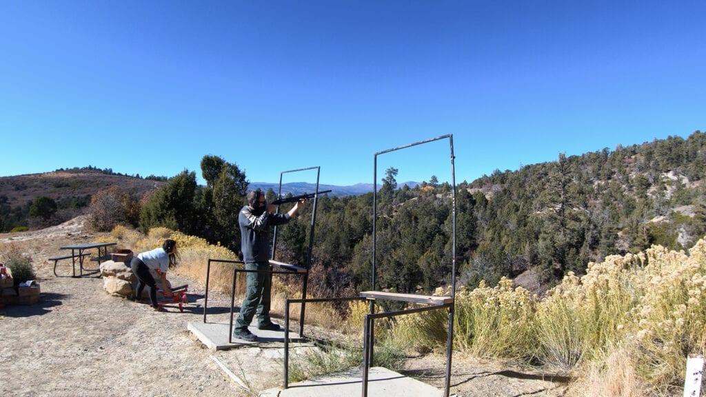 man skeet shooting in the mountains