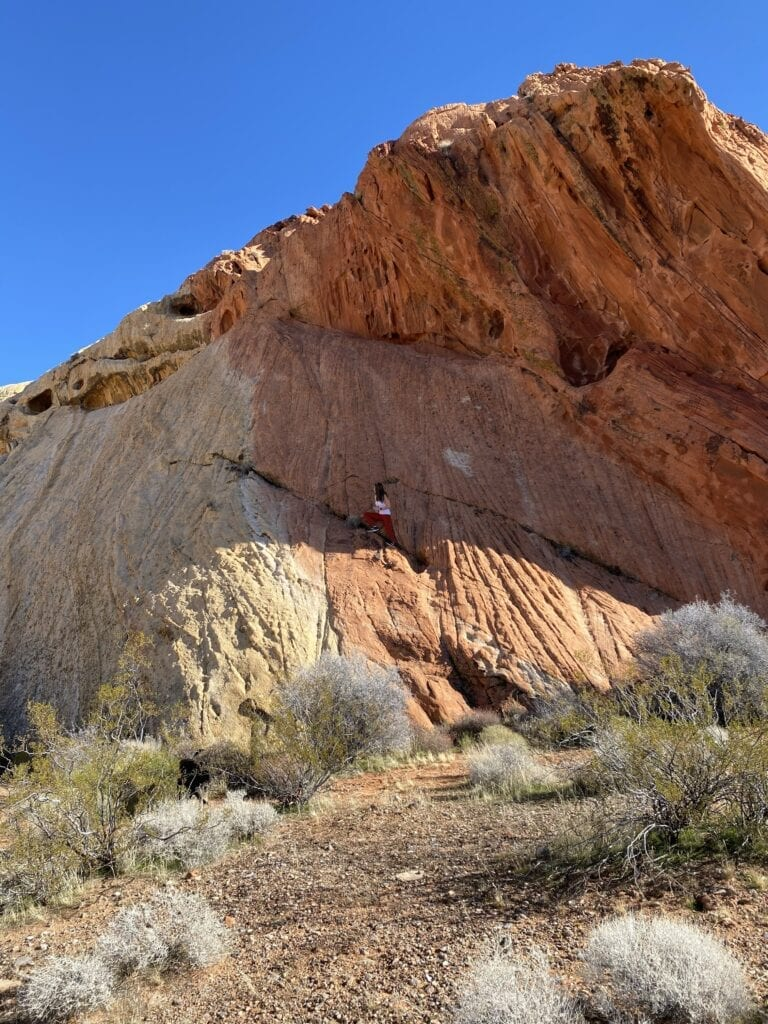 girl climbing mountain gold butte national monument