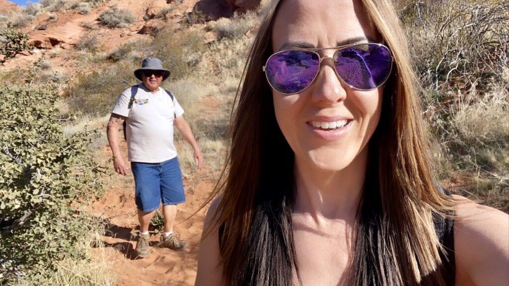 Girl and dad hiking elephant arch trail Utah
