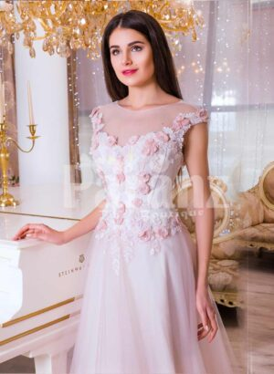 Women's light pink evening gown with long tulle skirt and pink flower appliquéd bodice