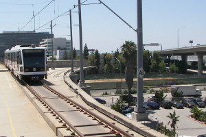 This is a recent view of the Green Line Station at Aviation Blvd. This shows construction from the 1990's that will be used to extend Light Rail to LAX. Also you can the tracks of the Santa Fe Harbor Line.