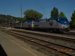 Train #6, the California Zephyr, is loading at the four-track Martinez station.  The foreground shows a bit of the former passenger platform that was replaced by the modern platforms in the distance.