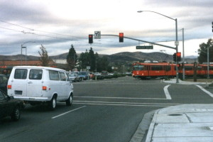 The San Diego Trolley crossing Mission Gorge Rd to enter the median on Cuyamuca Ave in Santee