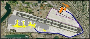 The orange oval in this picture is the CO NRAC. The blue line shows the connecting perimeter road to the terminal. This picture also show the station platforms and pedestrian bridge that will be built after 2016
