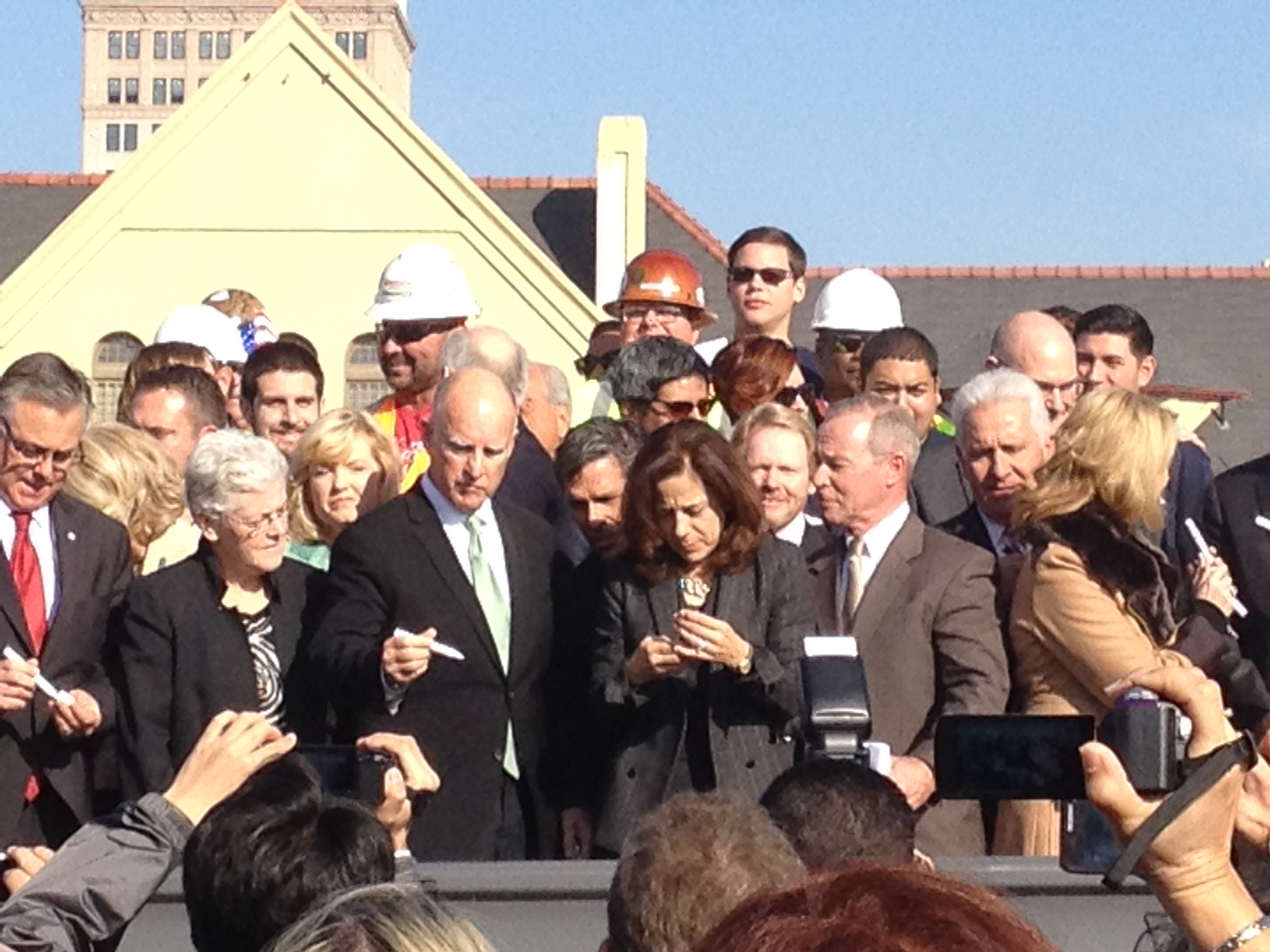 The Governor Signing the Symbolic Rail