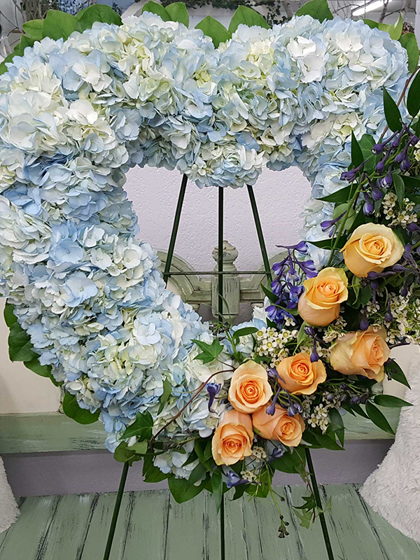 Blue Clouds Passing Heart Wreath with Swag