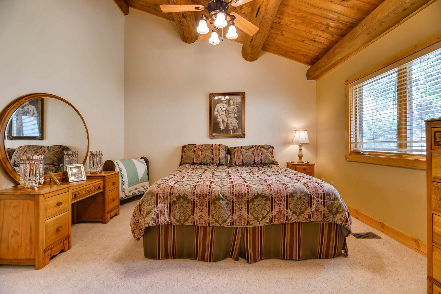 The first upper level bedroom has a king bed.