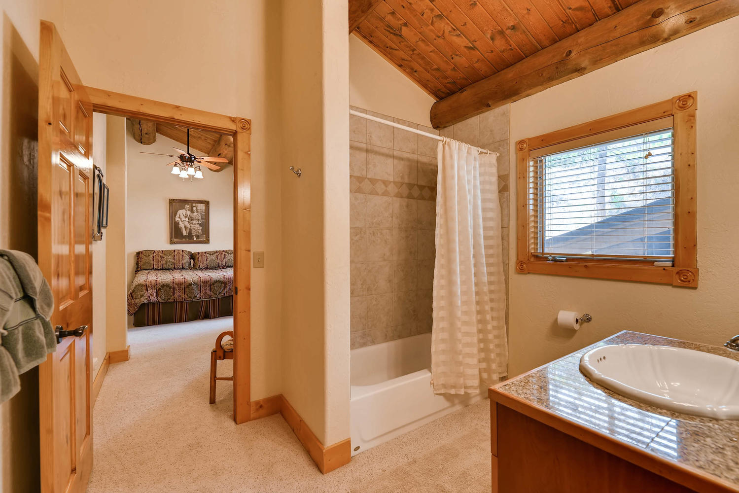 Upper level bathroom has a shower/tub combo.