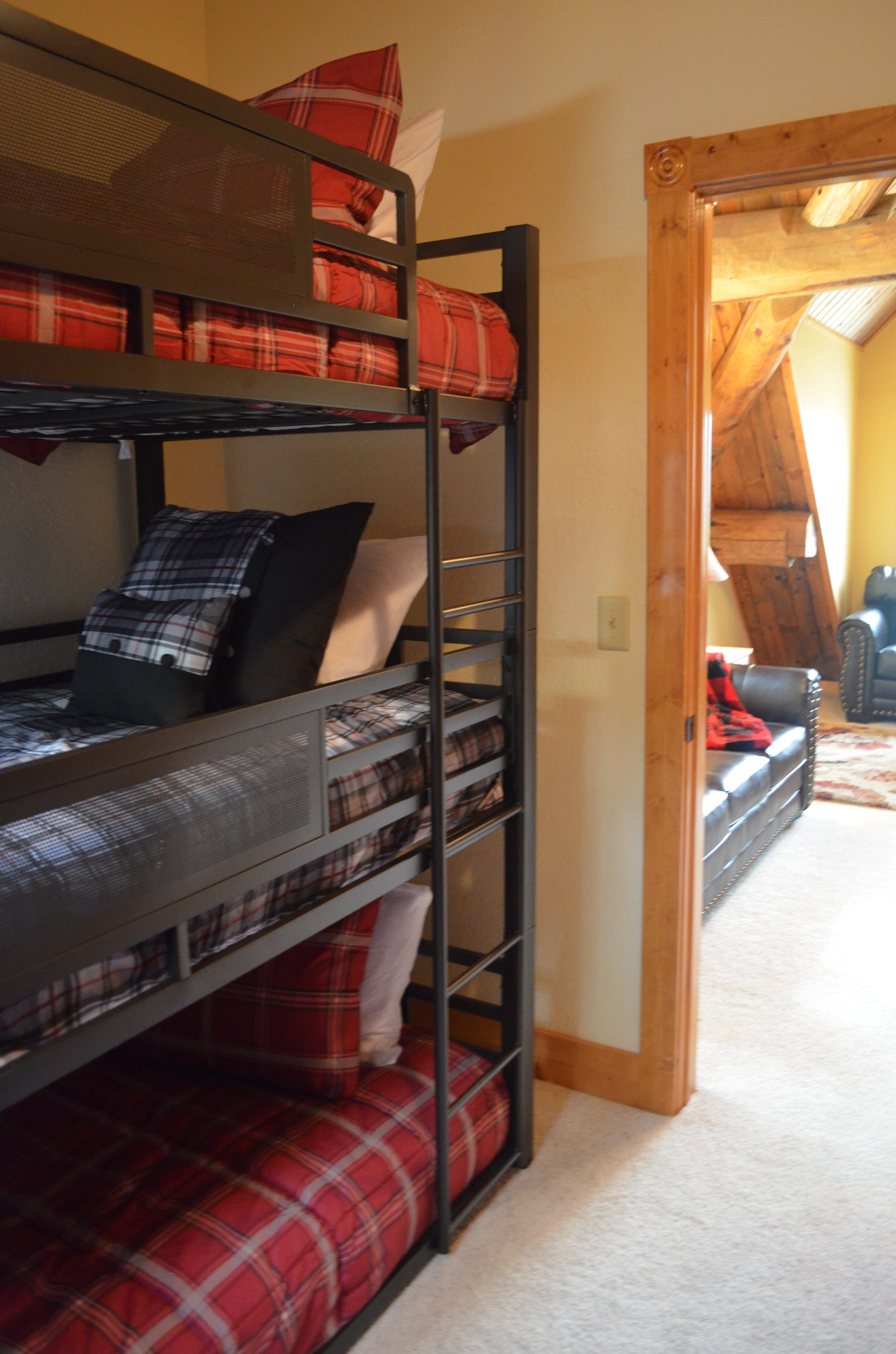 The second upper level bedroom has triple bunks on both sides of the room--sleeps 6.