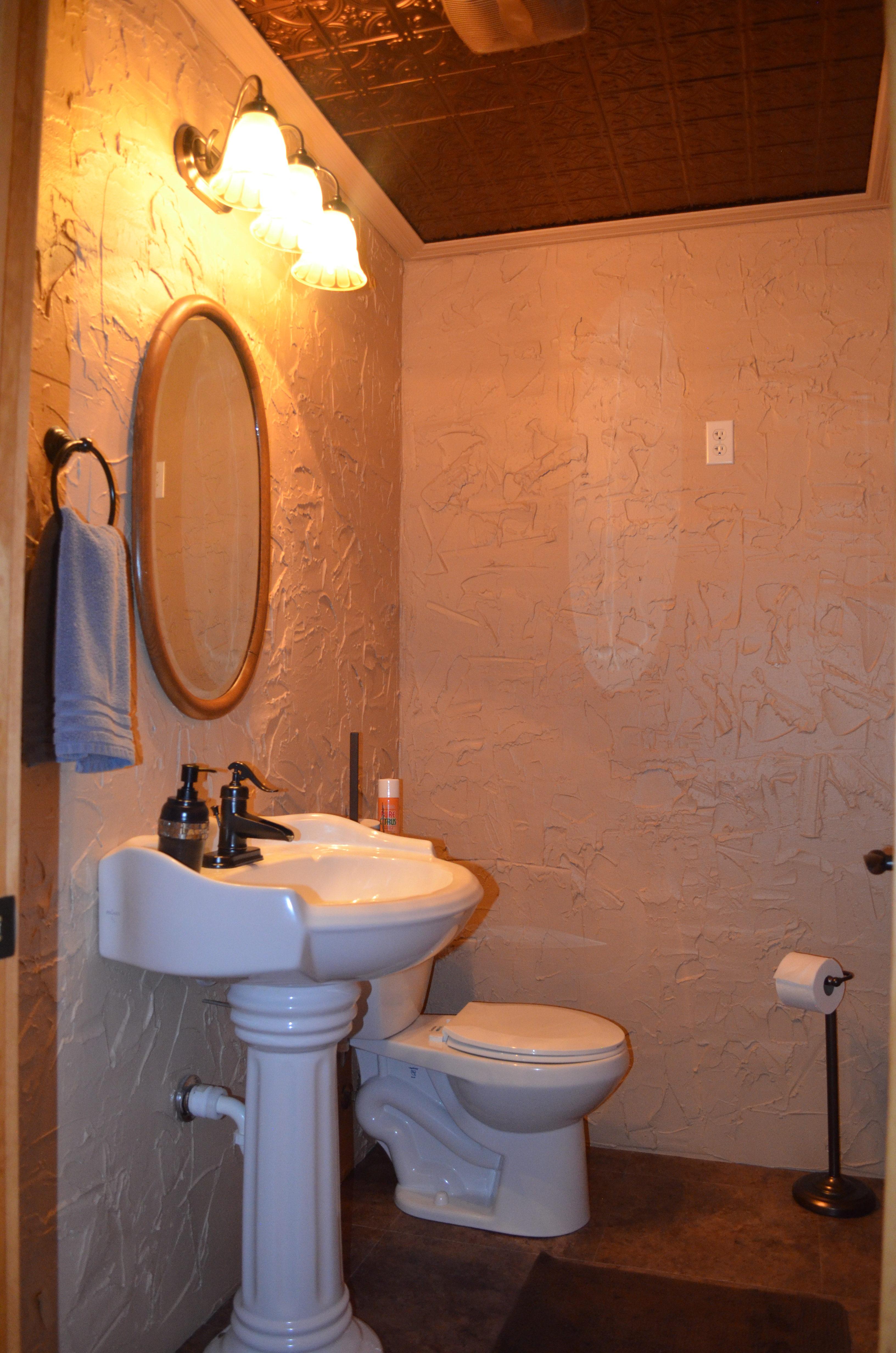 Lower level half bath.