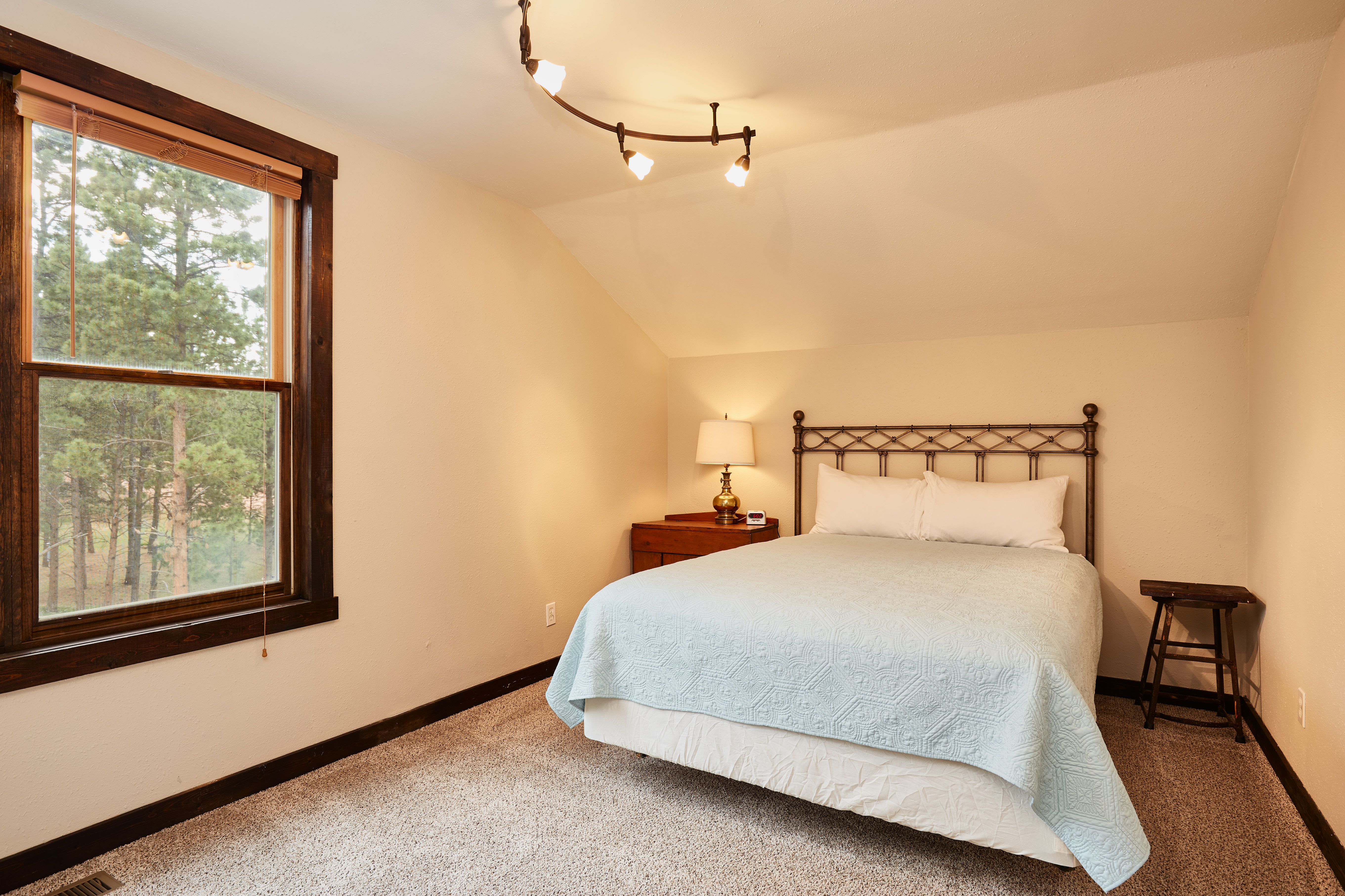 The third upstairs bedroom has also has a queen bed.
