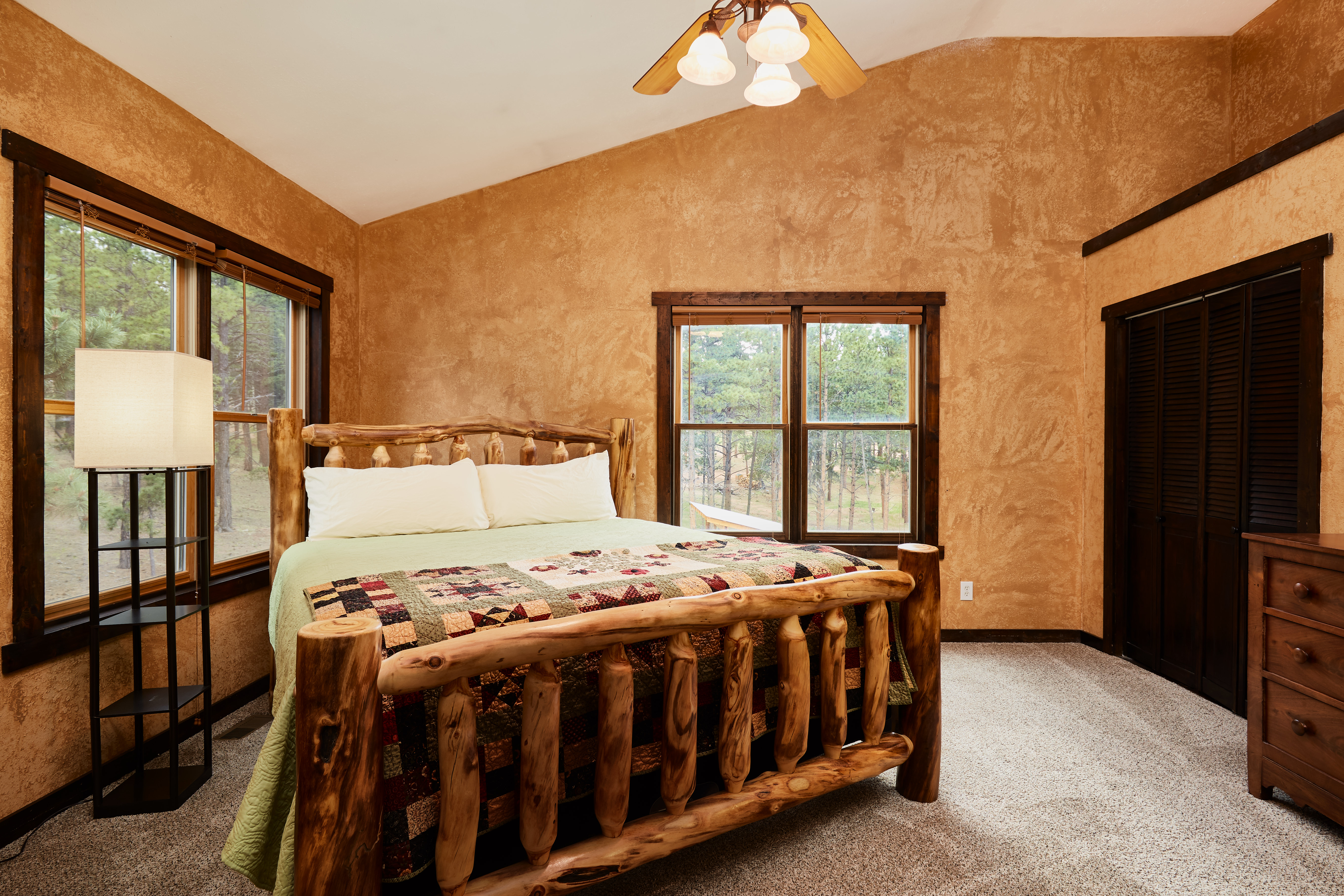 Upstairs, the master bedroom has large vaulted ceilings.