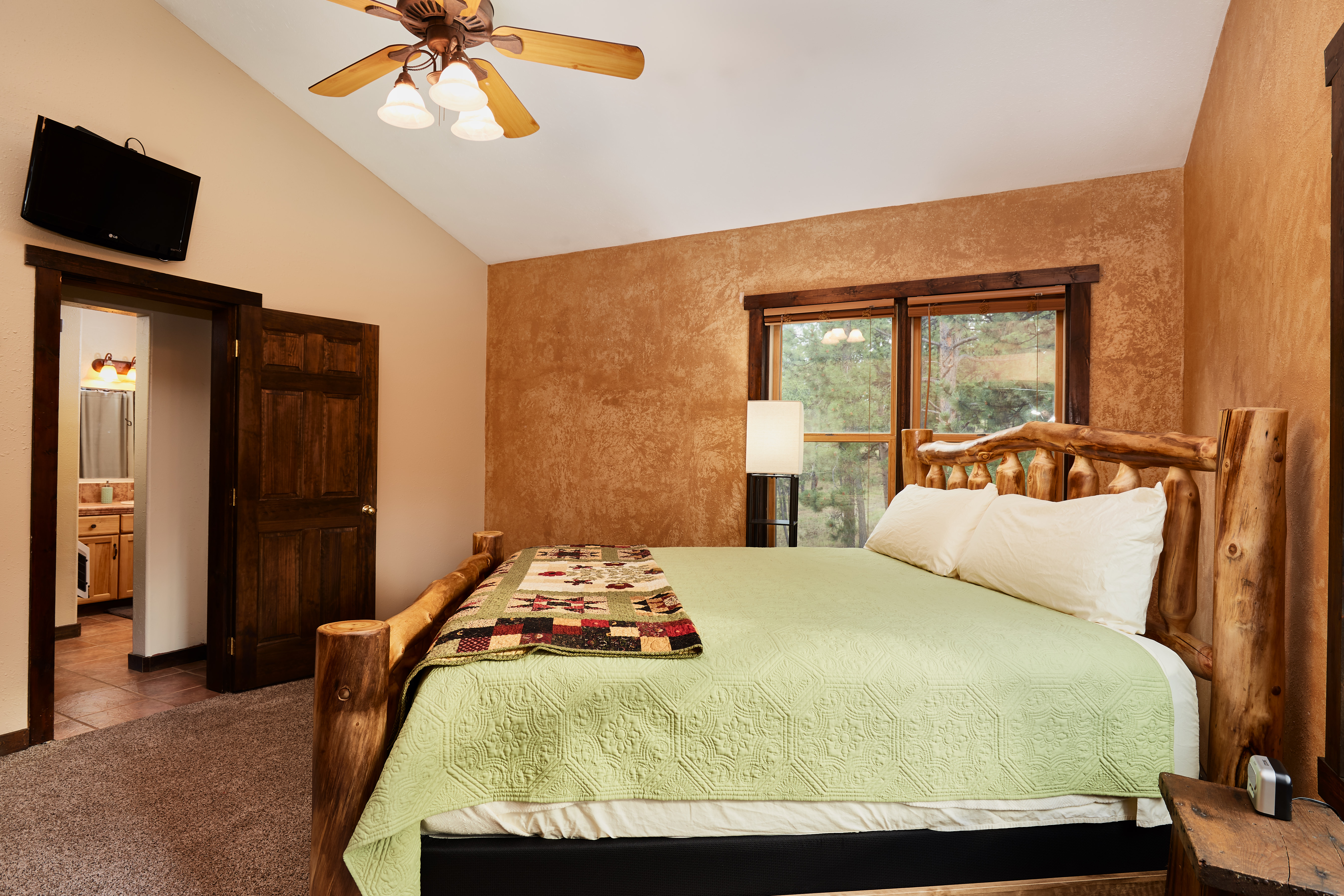 The upstairs master bedroom has a private entrance to the bathroom.
