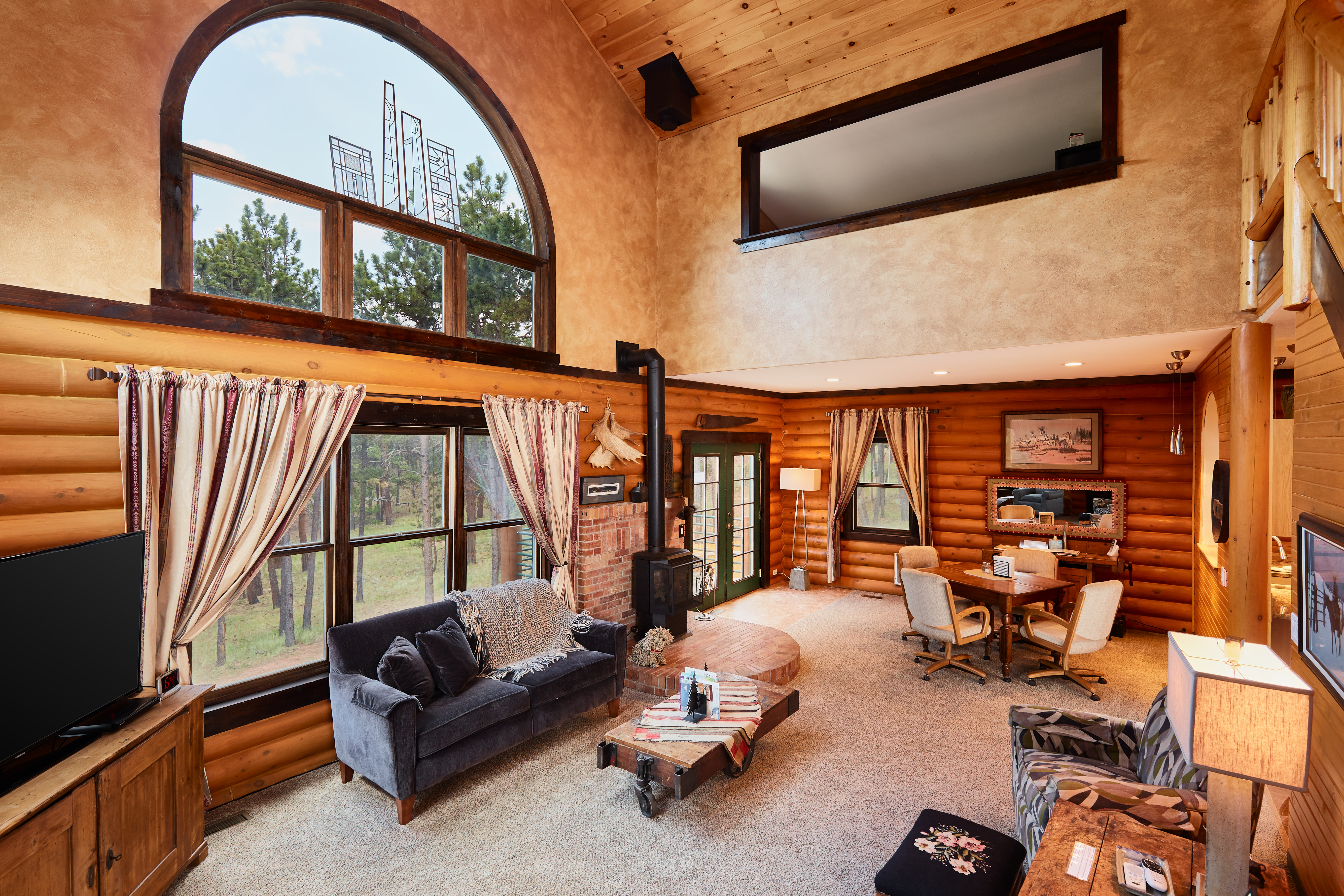 A gas fireplace keeps the room warm and cozy. French doors lead out to the deck with the grill.