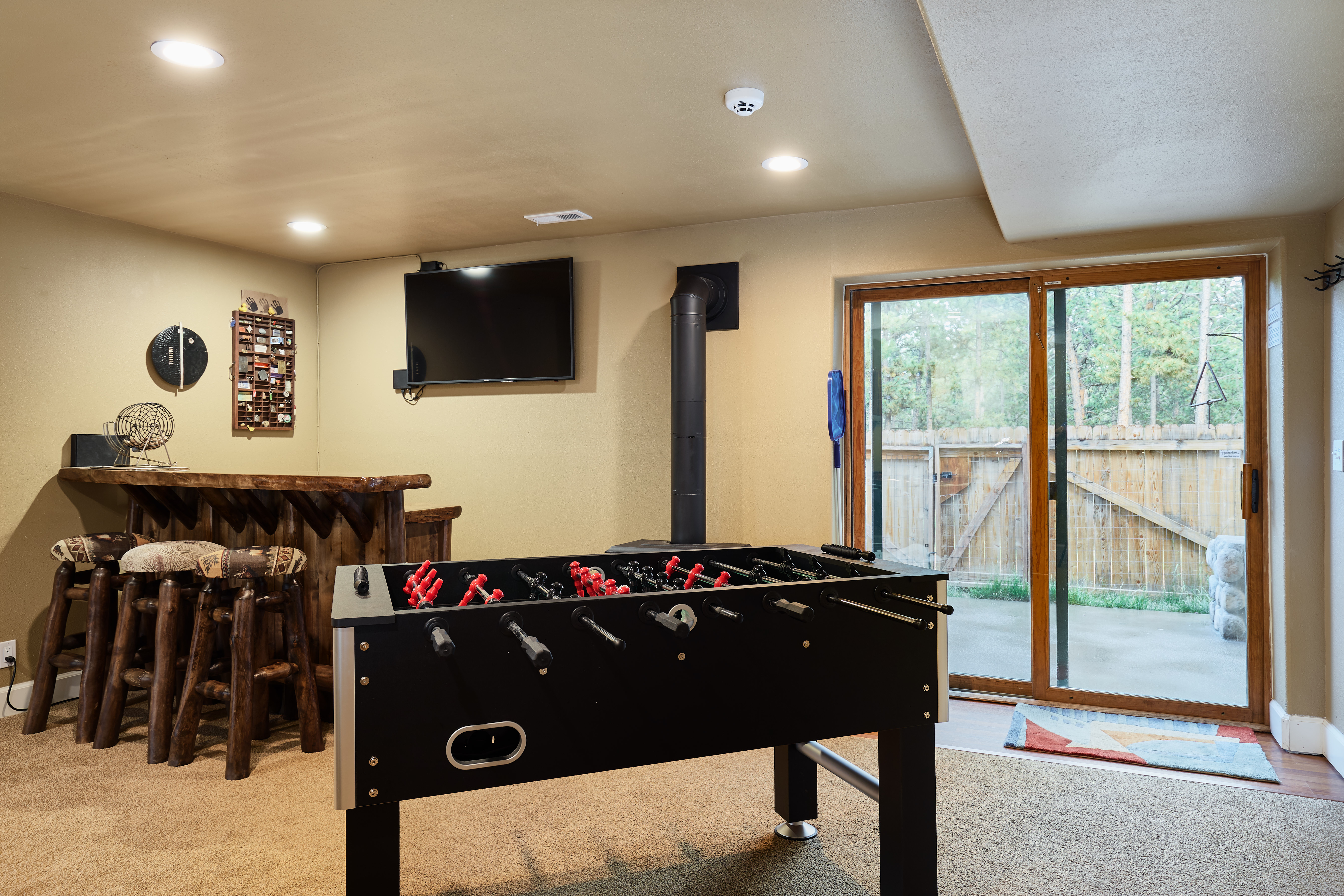 You can access to the patio and hot tub through the game room.