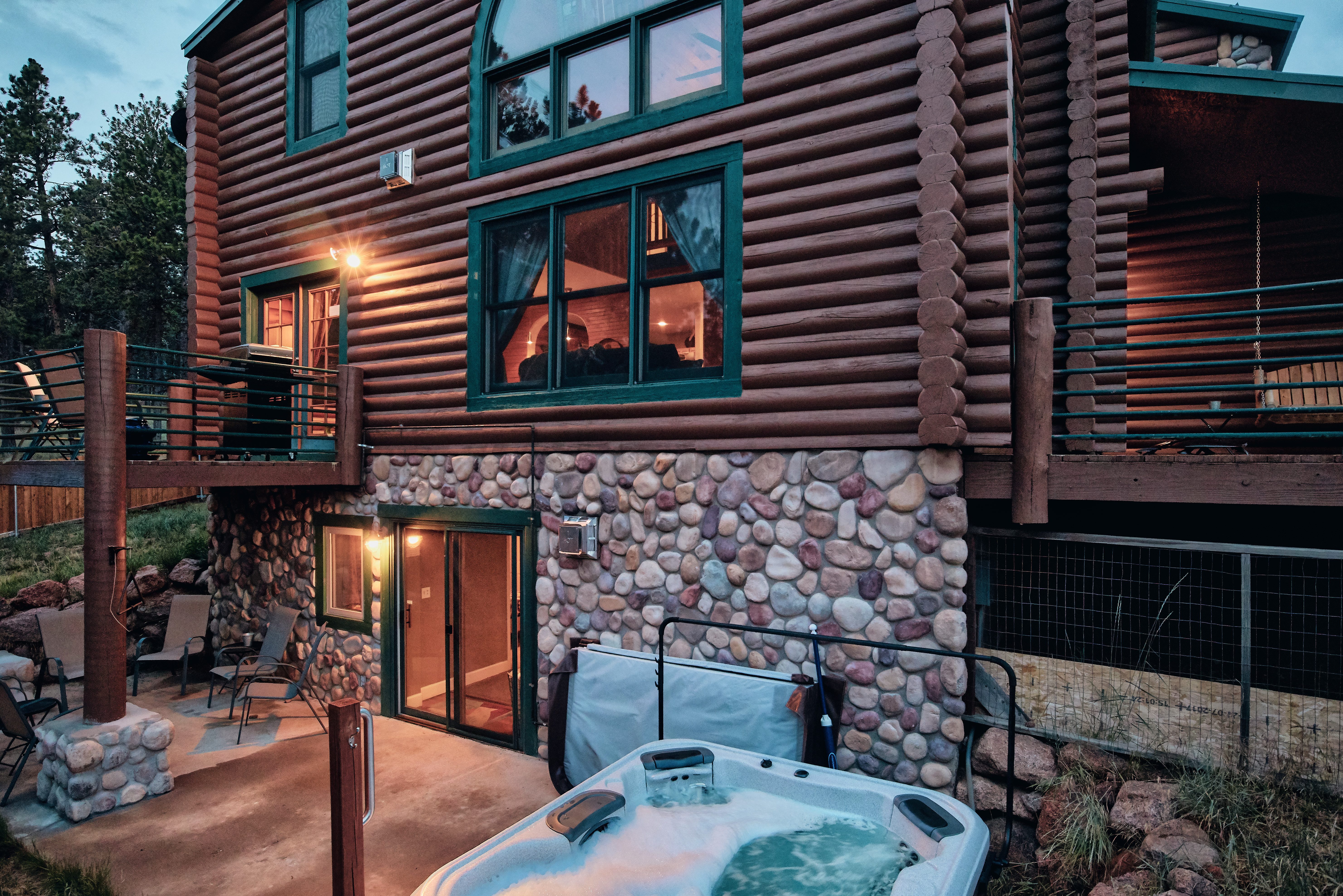 The hot tub and patio are around the side of the house.