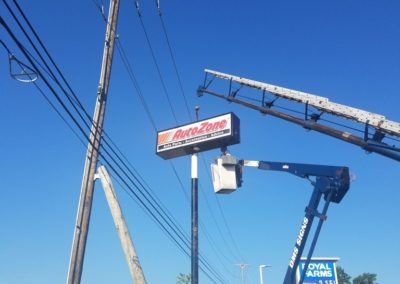 Autozone Illuminated Pylon Sign Installation with a crane and bucket truck in Maryland