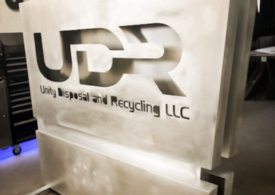 Production stage: Prepped for painting. Illuminated Monument sign that reads UDR Unity Disposal and Recycling LLC