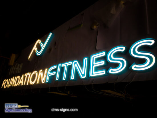 Exposed neon channel letter Foundation Fitness while being tested at DMS signs shop.