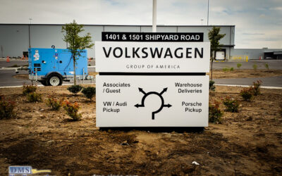 Illuminated architectural sign with directional info designed, manufactured and installed for Volkswagen Group of America
