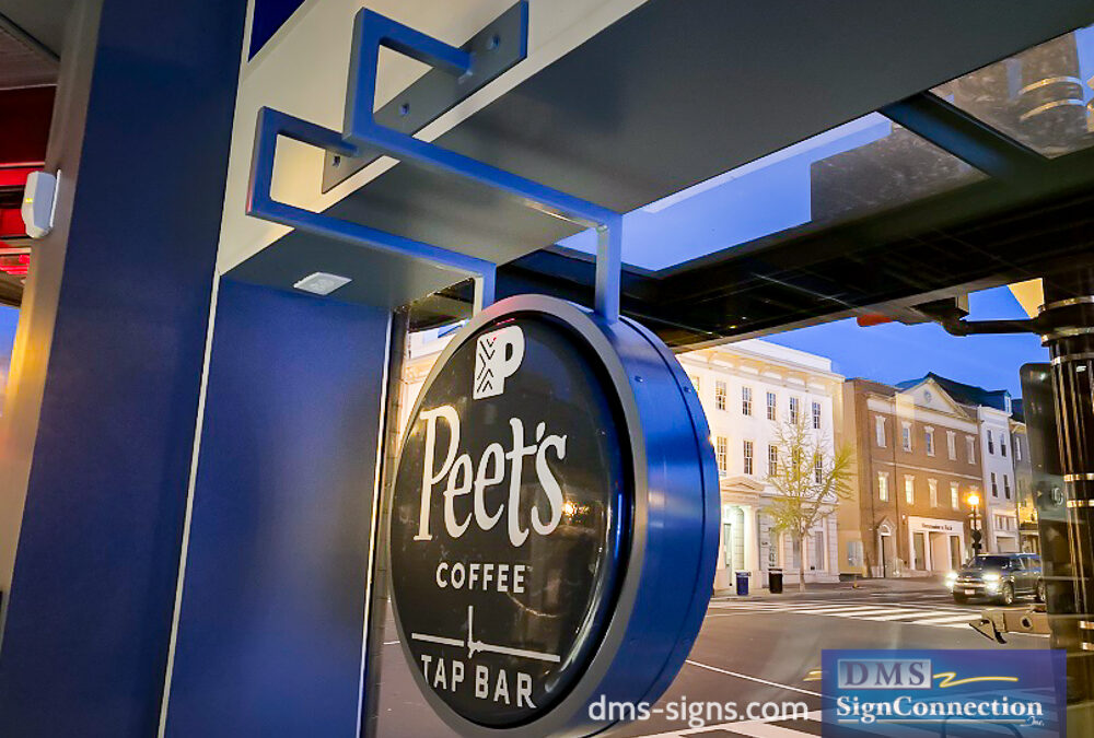 Window Sign For Peet's Coffee In Georgetown DC Installed With a Custom Bracket