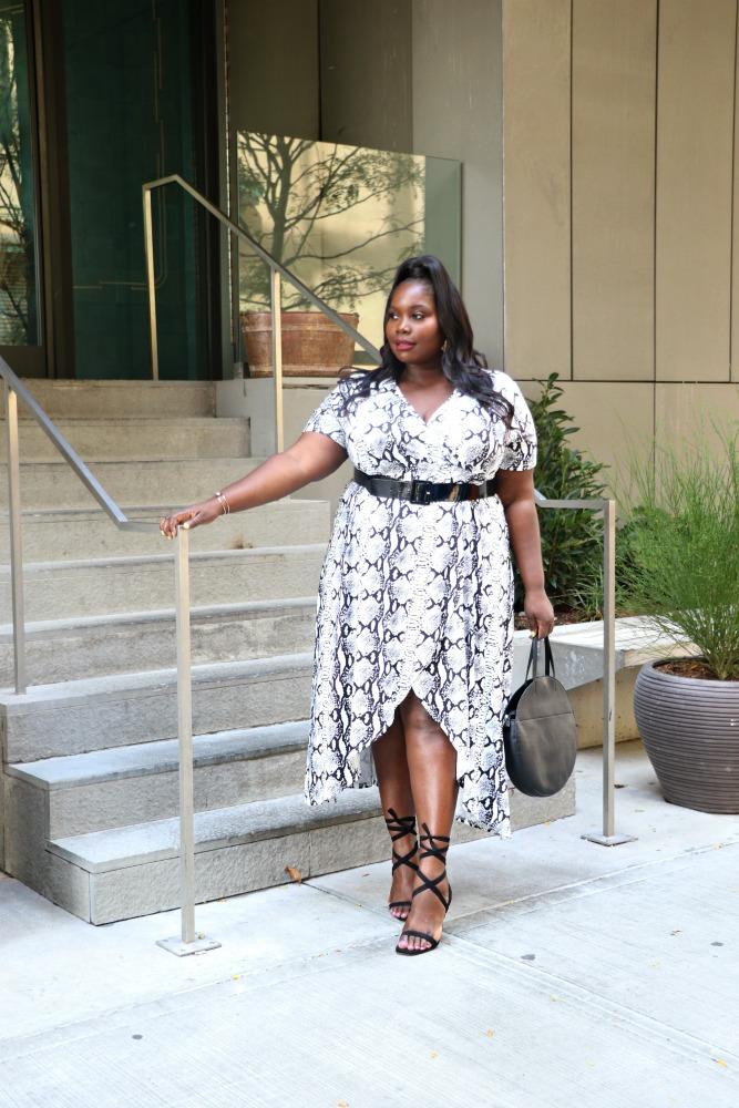 plus size woman in snake skin print dress