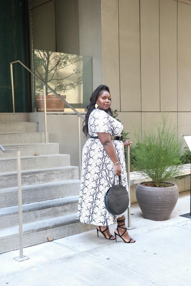 plus size woman in snakeskin print dress