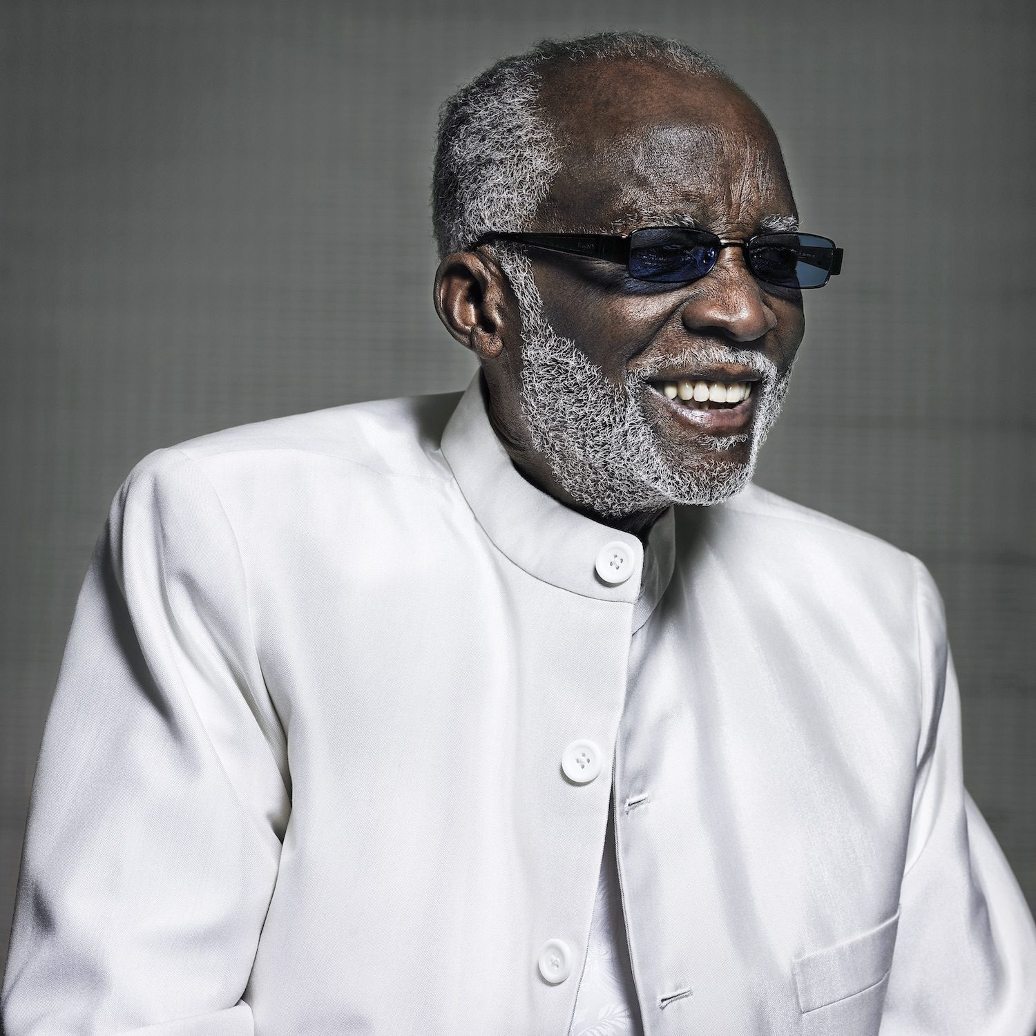 ahmad jamal in white suit