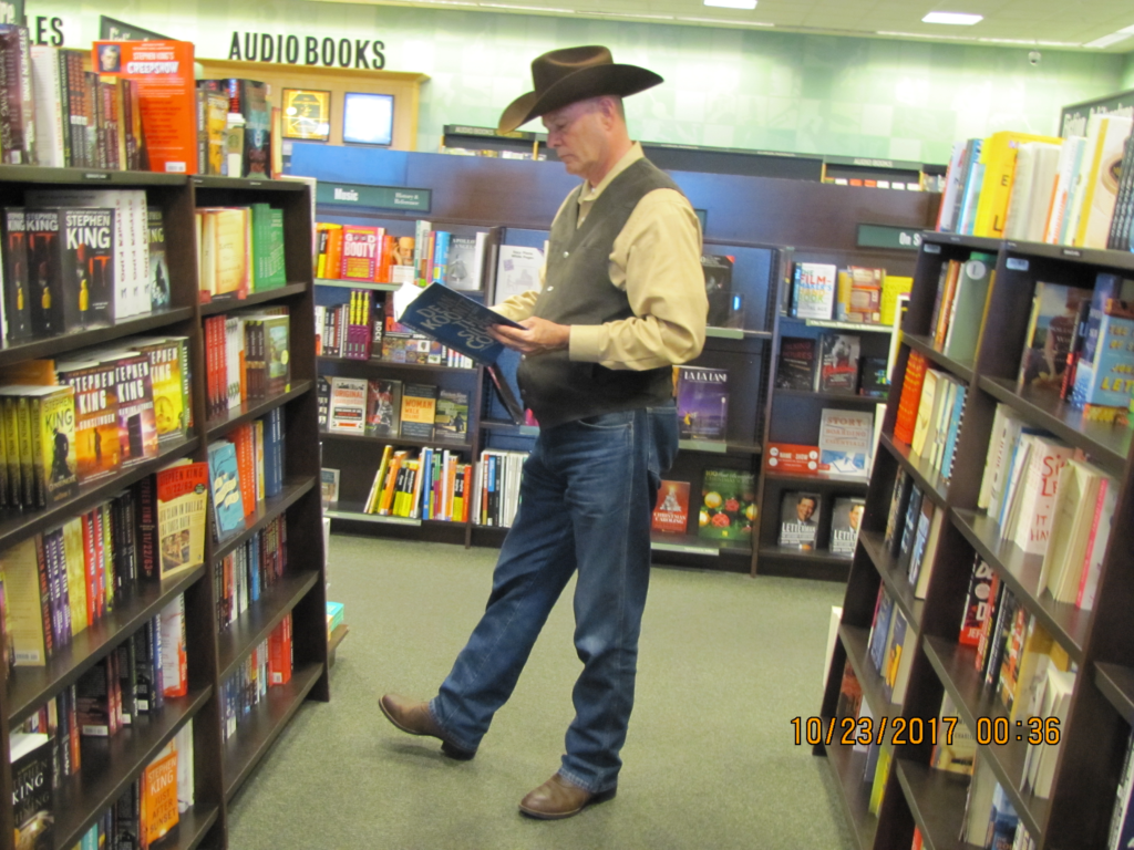 Best Selling Suspense and Thriller Author PG Barnett browsing the shelves at a Barnes and Noble