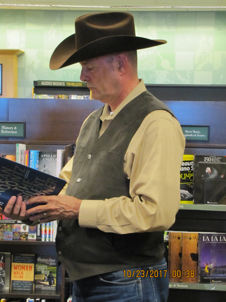 Best Selling Suspense and Thriller Author PG Barnett browsing the shelves at a Barnes and Noble #2