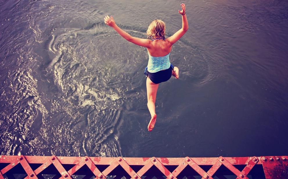 brave woman jumping off bridge